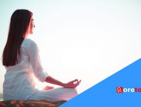woman-sitting-yoga-pose-beach-reflection-freepik